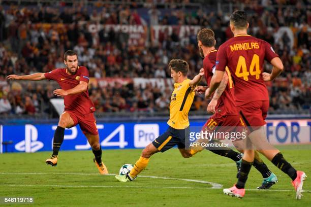 Atletico Madrid's Argentinian forward Luciano Vietto shoots on goal during the UEFA Champions League Group C football match between AS Roma and...