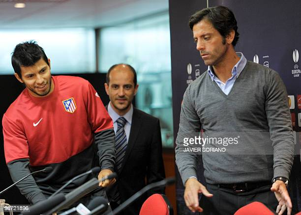 Atletico Madrid's Argentinian forward Sergio Aguero and Atletico Madrid's coach Quique Sanchez Flores arrive for a press conference before their...