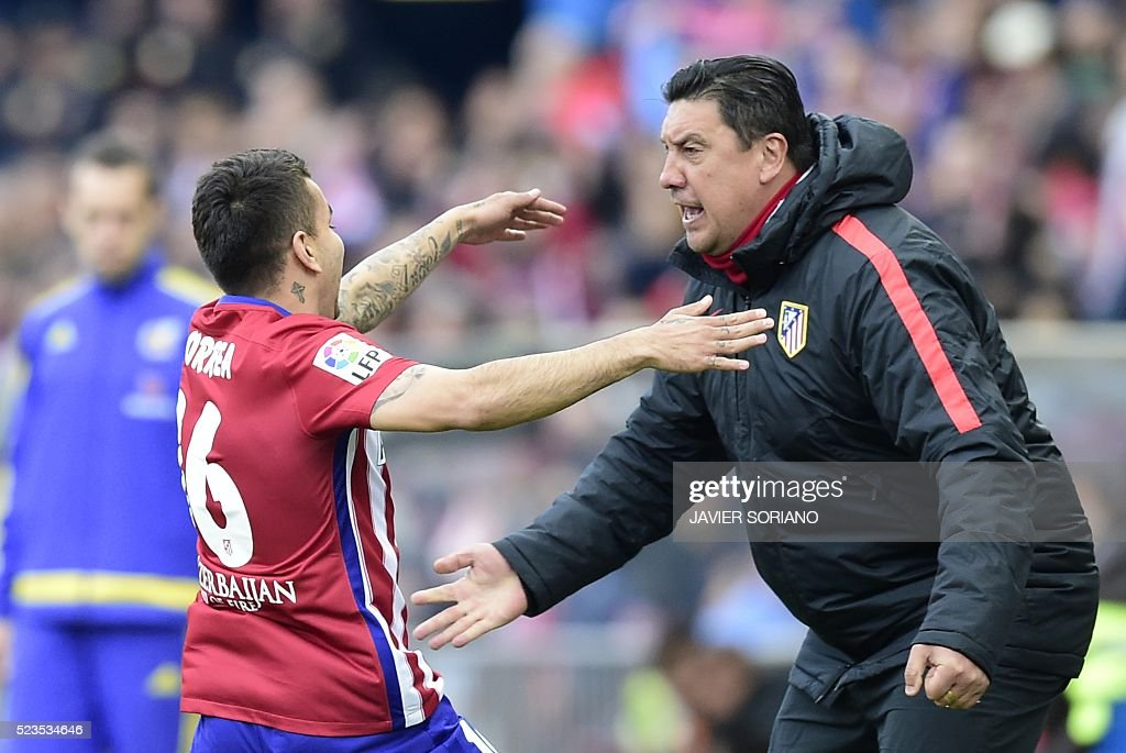 Atletico Madrid's Argentinian midfielder Angel Correa celebrates with Atletico Madrid's Argentinian assistant coach German Burgos after scoring a...