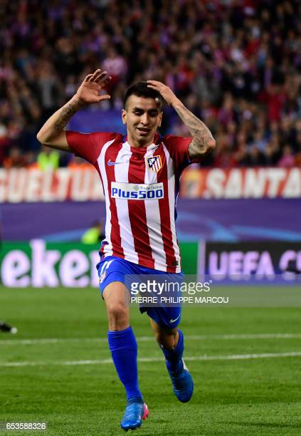 Atletico Madrid's Argentinian midfielder Angel Correa gestures after missing a shot during the UEFA Champions League round of 16 second leg football...