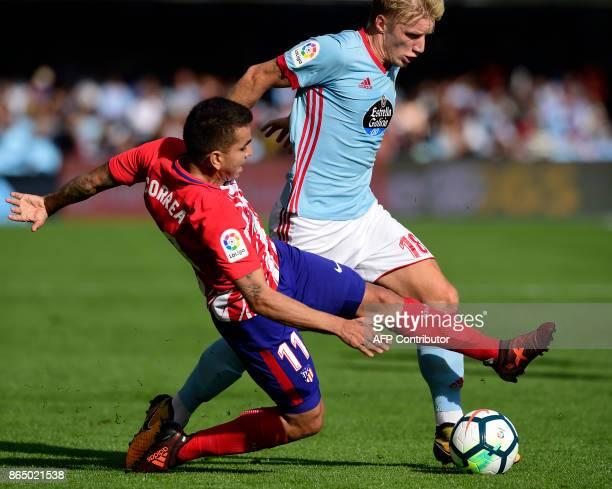 Atletico Madrid's Argentinian midfielder Angel Correa vies with Celta Vigo's Danish midfielder Daniel Wass during the Spanish league football match...