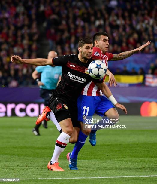 Atletico Madrid's Argentinian midfielder Angel Correa vies with Leverkusen's Austrian defender Aleksandar Dragovic during the UEFA Champions League...