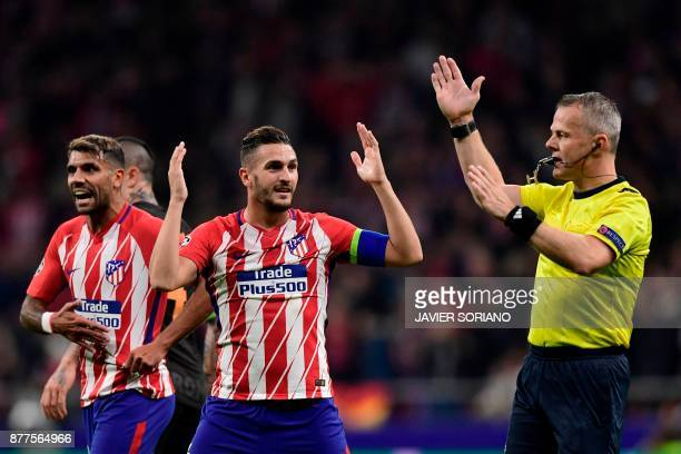 Atletico Madrid's Argentinian midfielder Augusto Fernandez and Atletico Madrid's Spanish midfielder Koke as Dutch referee Bjorn Kuipers disallows a...