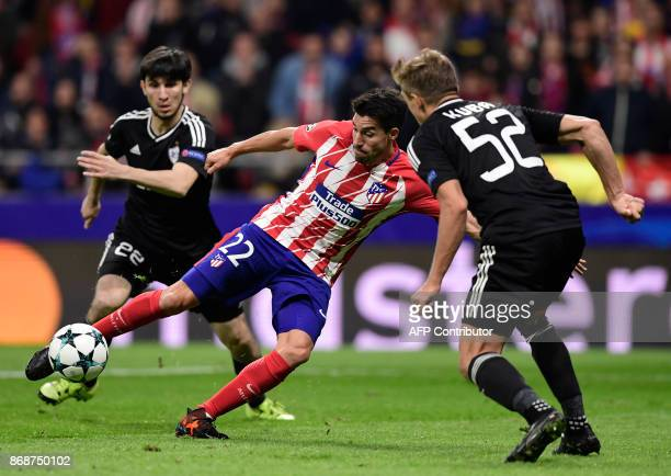 Atletico Madrid's Argentinian midfielder Nico Gaitan vies with Qarabag's Polish defender Jakub Rzezniczak during the UEFA Champions League football...