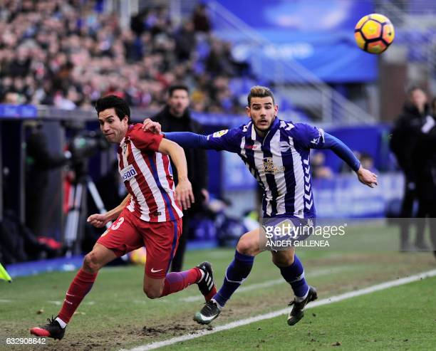 Atletico Madrid's Argentinian midfielder Nicolas Gaitan vies with Deportivo Alaves' French defender Theo Hernandez during the Spanish league football...