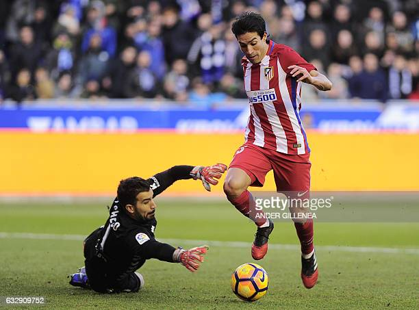 Atletico Madrid's Argentinian midfielder Nicolas Gaitan vies with Deportivo Alaves' goalkeeper Fernando Pacheco during the Spanish league football...