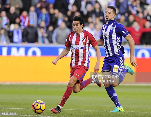 Atletico Madrid's Argentinian midfielder Nicolas Gaitan vies with Deportivo Alaves' Moroccan defender Zouhair Feddal during the Spanish league...
