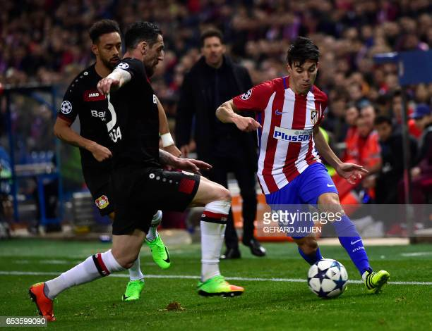Atletico Madrid's Argentinian midfielder Nicolas Gaitan vies with Leverkusen's defender Roberto Hilbert during the UEFA Champions League round of 16...