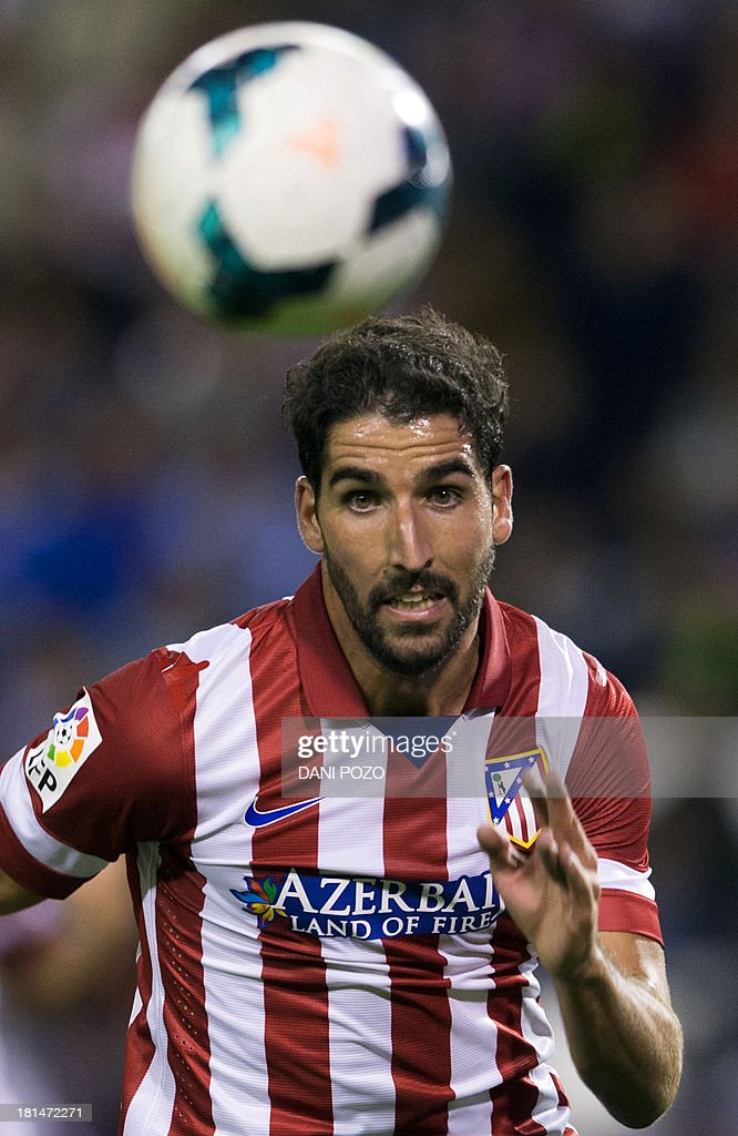 Atletico Madrid's Argentinian midfielder Raul Garcia chases the ball during the Spanish league football match Valladolid vs Atletico Madrid at Nuevo Jose Zorrilla stadium in Valladolid on September 21, 2013.
