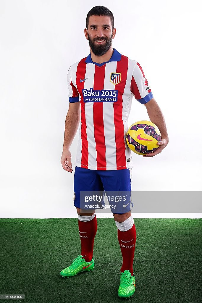 Atletico Madrid's attacking midfielder <a gi-track='captionPersonalityLinkClicked' href=/galleries/search?phrase=Arda+Turan&family=editorial&specificpeople=2179402 ng-click='$event.stopPropagation()'>Arda Turan</a> poses with new jersey of club on February 07, 2015 in Madrid, Spain. The Baku 2015 European Games has today announced an agreement with Atletico Madrid for the Spanish football champions to feature the inaugural European Games logo on the clubs jersey for the rest of the 2014-15 UEFA Champions League competition and a series of matches in La Liga, Spains domestic championship.