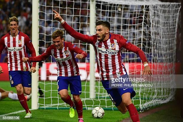 Atletico Madrid's Belgian forward Yannick Ferreira Carrasco celebrates after scoring a goal next to Atletico Madrid's French forward Antoine...