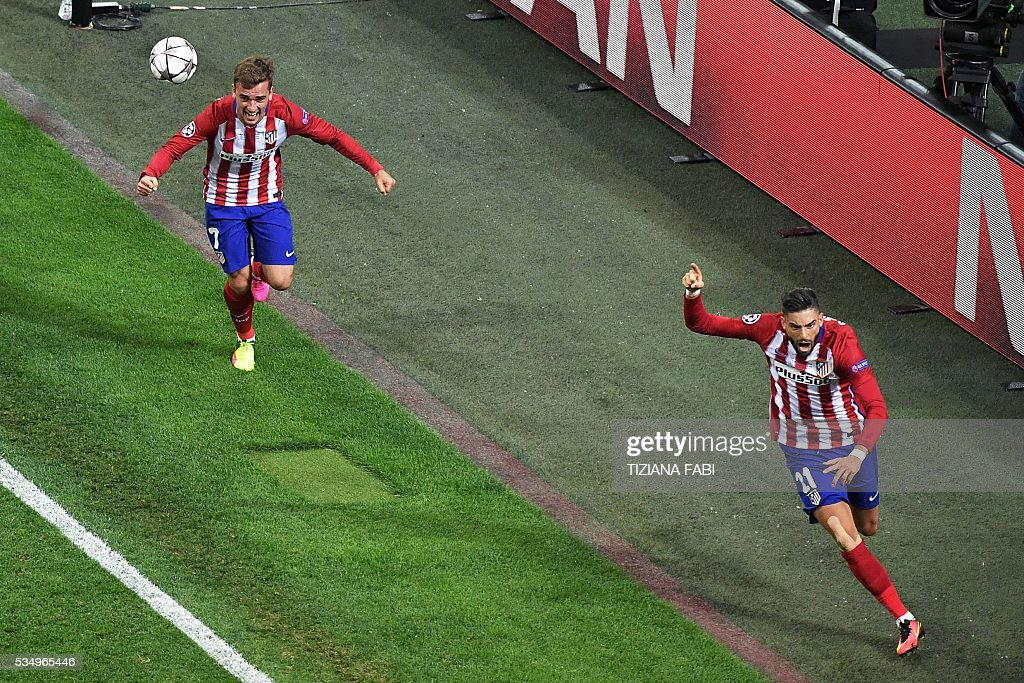 Atletico Madrid's Belgian forward Yannick Ferreira Carrasco (R) celebrates with team mate Atletico Madrid's French forward Antoine Griezmann after scoring a goal during the UEFA Champions League final football match between Real Madrid and Atletico Madrid at San Siro Stadium in Milan, on May 28, 2016. / AFP / TIZIANA