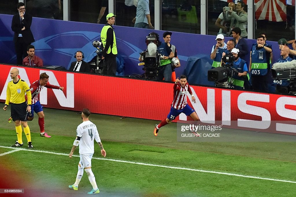 Atletico Madrid's Belgian forward Yannick Ferreira Carrasco celebrates a goal during the UEFA Champions League final football match between Real Madrid and Atletico Madrid at San Siro Stadium in Milan, on May 28, 2016. / AFP / GIUSEPPE