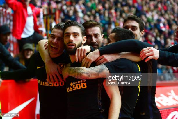 Atletico Madrid's Belgian forward Yannick Ferreira Carrasco celebrates with teammates after scoring a goal during the Spanish league football match...