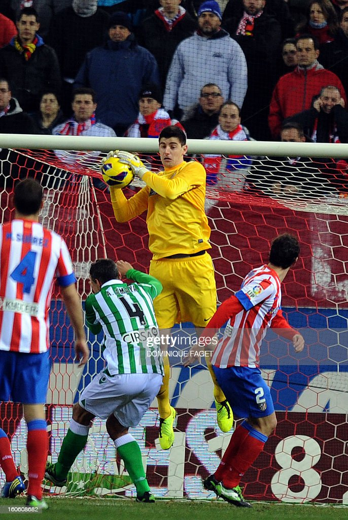 Atletico Madrid's Belgian goalkeeper Thibaut Courtois (C) catches the ball during the Spanish league football match Atletico de Madrid vs Real Betis at the Vicente Calderon stadium in Madrid on February 3, 2013.