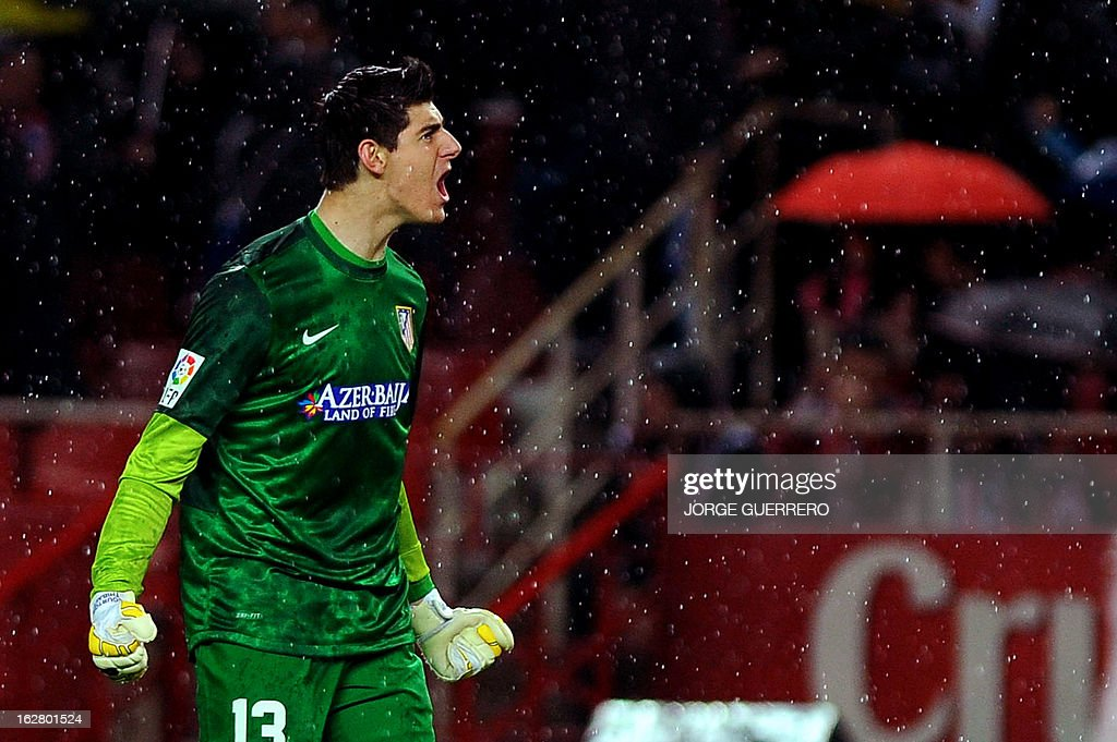 Atletico Madrid's Belgian goalkeeper Thibaut Courtois celebrates his team's score during the Copa del Rey (King's Cup) semi-final second leg football match Sevilla FC vs Atletico de Madrid at the Ramon Sanchez Pizjuan staduim in Sevilla on February 27, 2013. AFP PHOTO / JORGE GUERRERO