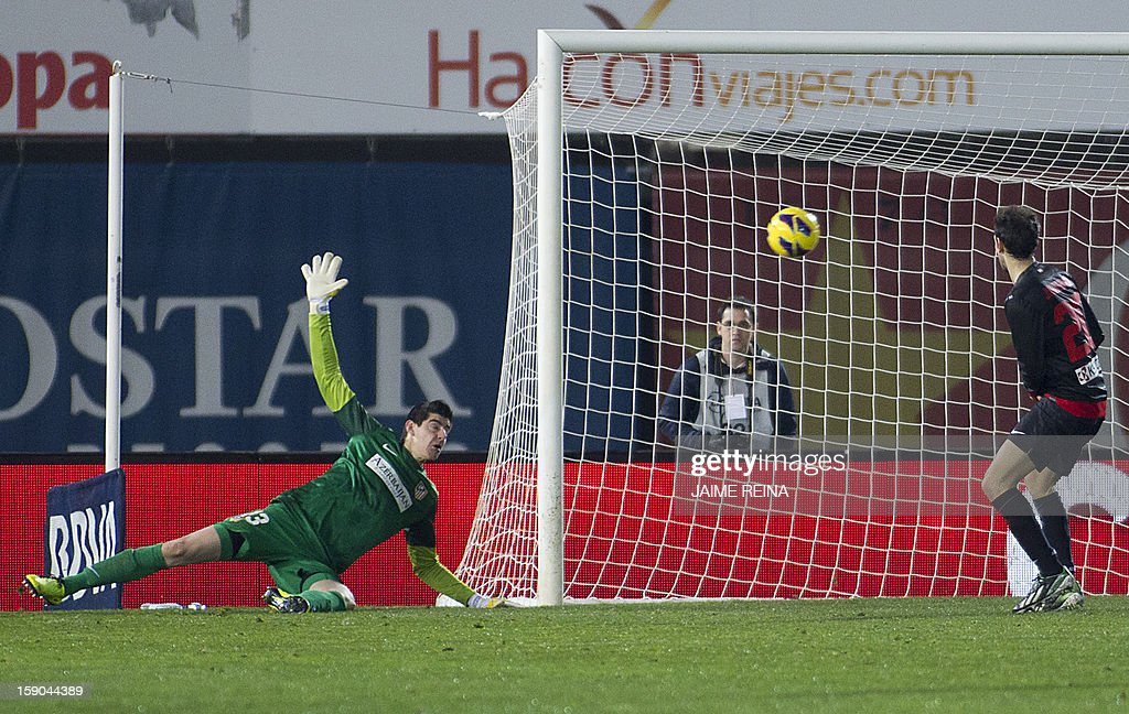 Atletico Madrid's Belgian goalkeeper Thibaut Courtois (L) watches the ball heading to his net during the Spanish league football match RCD Mallorca vs Club Atletico de Madrid at the Iberostar estadi stadium in Palma de Mallorca on January 6, 2013.