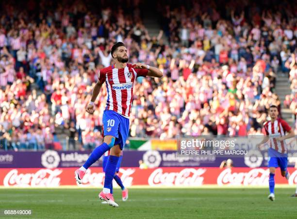 Atletico Madrid's Belgian midfielder Yannick Ferreira Carrasco celebrates after scoring during the Spanish league football match Atletico de Madrid...