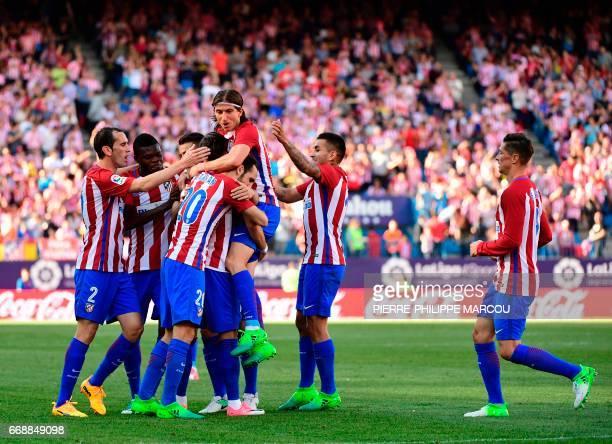 Atletico Madrid's Belgian midfielder Yannick Ferreira Carrasco celebrates after scoring during the Spanish league football match Atletico de Madrid...