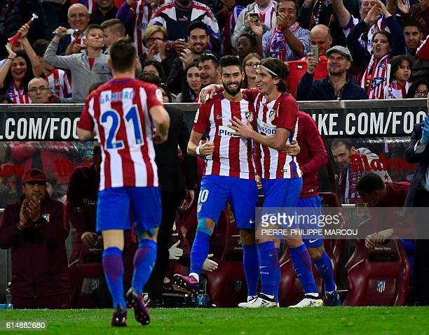 Atletico Madrid's Belgian midfielder Yannick Ferreira Carrasco celebrates his third goal with Atletico Madrid's Brazilian defender Filipe Luis during...