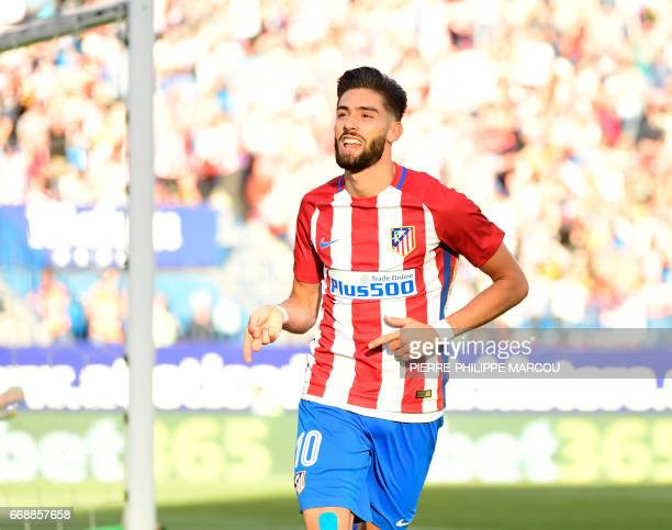 Atletico Madrid's Belgian midfielder Yannick Ferreira Carrasco celebrates his second goal during the Spanish league football match Atletico de Madrid...