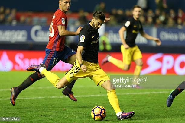 Atletico Madrid's Belgian midfielder Yannick Ferreira Carrasco scores during the Spanish league football match CA Osasuna vs Club Atletico de Madrid...