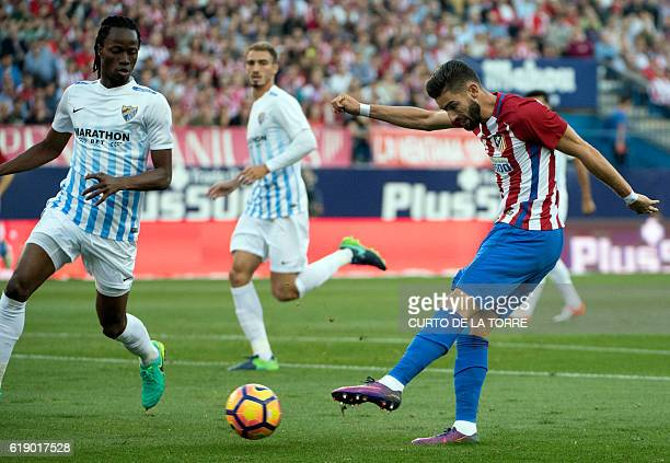 Atletico Madrid's Belgian midfielder Yannick Ferreira Carrasco shoots to score a goal during the Spanish league football match between Club Atletico...
