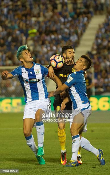 Atletico Madrid's Belgian midfielder Yannick Ferreira Carrasco vies with Leganes' defender Bustinza during the Spanish league football match Club...
