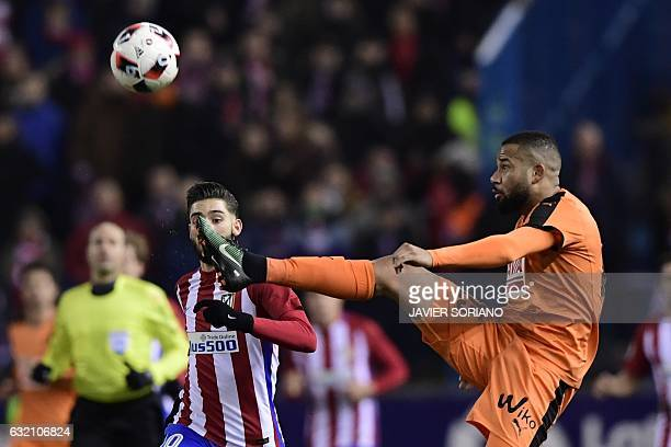 Atletico Madrid's Belgian midfielder Yannick Ferreira Carrasco vies with Eibar's midfielder Bebe during the Spanish Copa del Rey quarter final first...