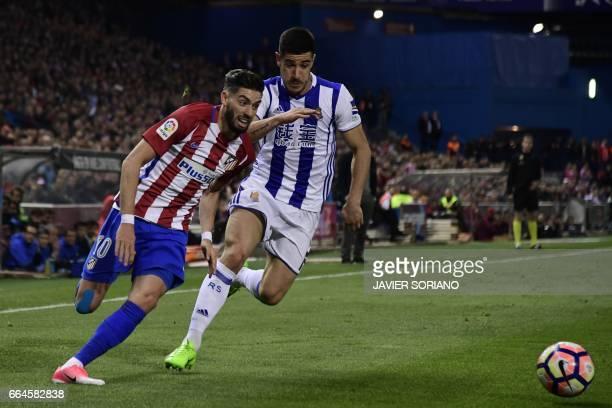 Atletico Madrid's Belgian midfielder Yannick Ferreira Carrasco vies with Real Sociedad's defender Yuri Berchiche during the Spanish league football...