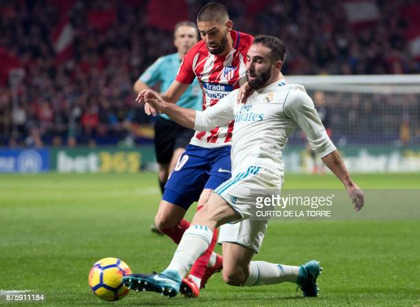 Atletico Madrid's Belgian midfielder Yannick FerreiraCarrasco vies with Real Madrid's Spanish defender Dani Carvajal during the Spanish league...