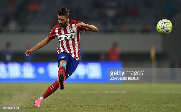 Atletico Madrid's Belgium midfielder Yannick Ferreira Carrasco kicks the ball during a friendly football match between Shanghai SIPG and Atletico...
