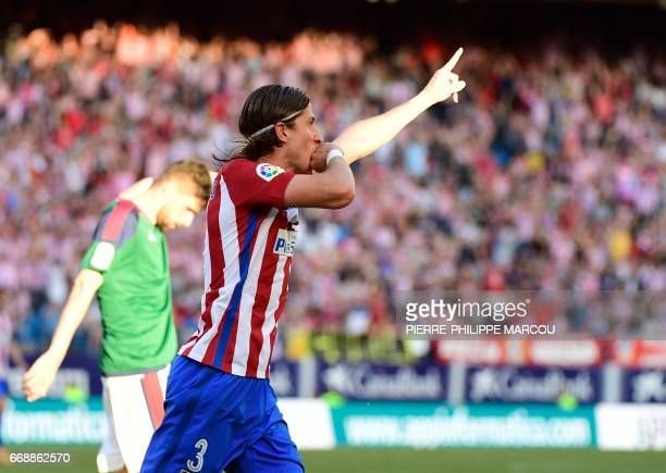 Atletico Madrid's Brazilian defender Filipe Luis celebrates after scoring during the Spanish league football match Atletico de Madrid vs Osasuna at...