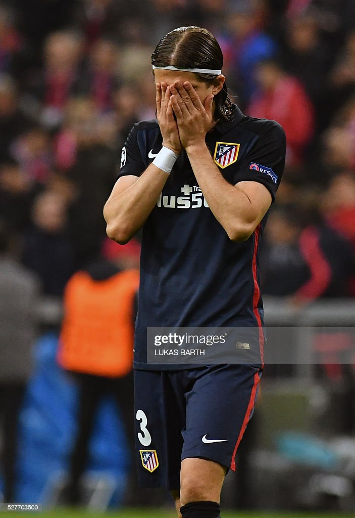 Atletico Madrid's Brazilian defender Filipe Luis reacts during the UEFA Champions League semi-final, second-leg football match between FC Bayern Munich and Atletico Madrid in Munich, southern Germany, on May 3, 2016. / AFP / LUKAS