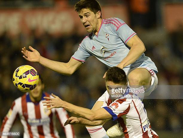 Atletico Madrid's Brazilian defender Guilherme Siqueira vies with Celta's defender Andreu Fontas during the Spanish league football match RC Celta de...