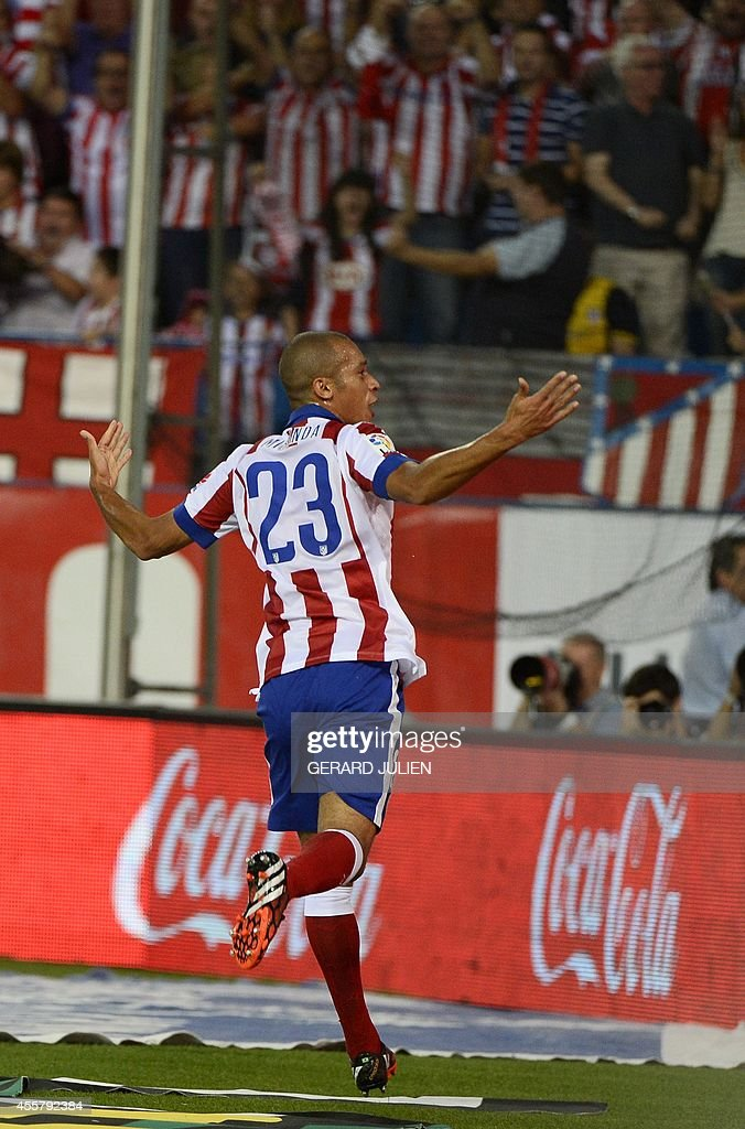 Atletico Madrid's Brazilian defender Joao Miranda celebrates after scoring during the Spanish league football match Club Atletico de Madrid vs Celta...