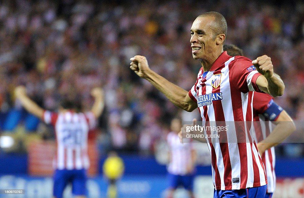 Atletico Madrid's Brazilian defender Joao Miranda de Souza celebrates after scoring during the UEFA Champions league football match Atletico de...
