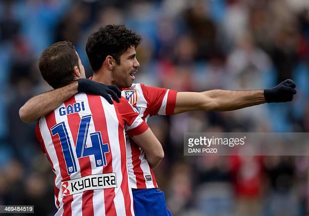 Atletico Madrid's Brazilian forward Diego da Silva Costa and Atletico Madrid's midfielder and captain Gabi celebrate after scoring during the Spanish...