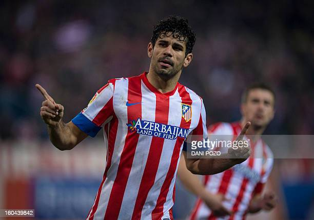 Atletico Madrid's Brazilian forward Diego da Silva Costa celebrates his second goal after scoring on a penalty kick during the Spanish Copa del Rey...