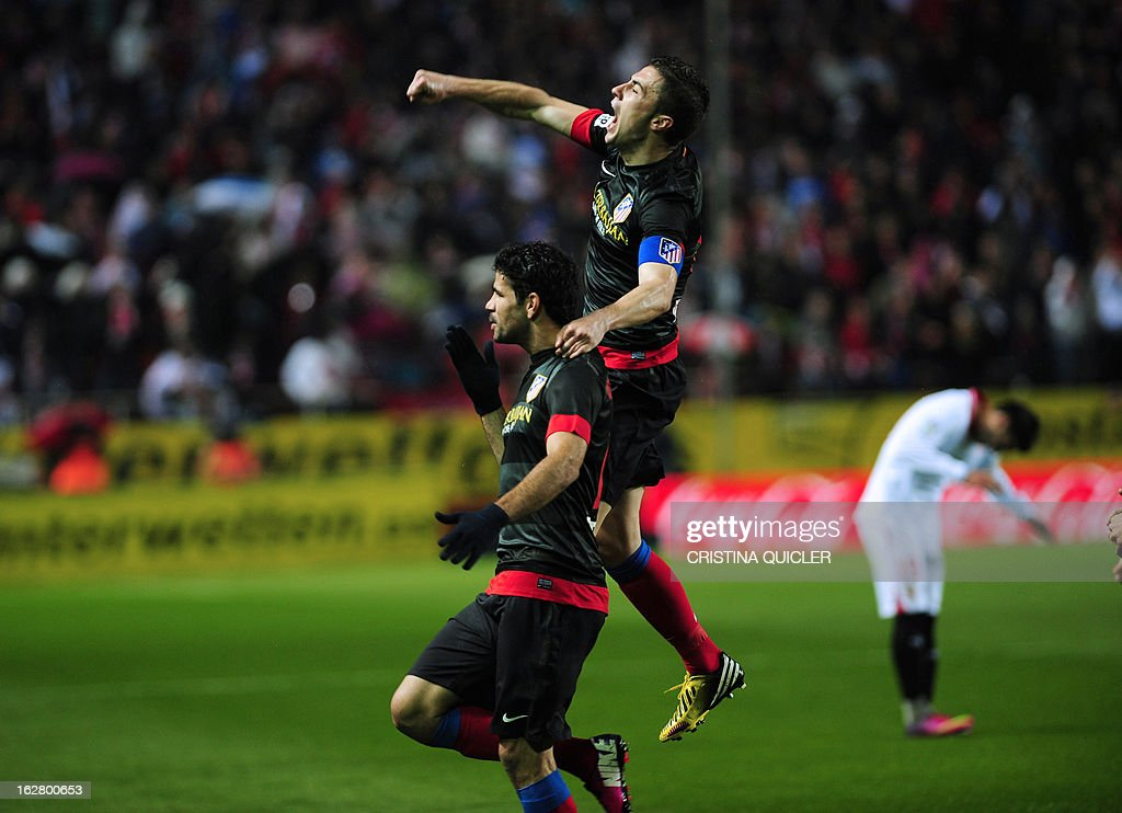 Atletico Madrid's Brazilian forward Diego da Silva Costa (down) celebrates after scoring during the Copa del Rey (King's Cup) semi-final second leg football match Sevilla FC vs Atletico de Madrid at the Ramon Sanchez Pizjuan staduim in Sevilla on February 27, 2013.