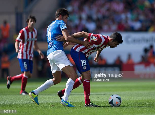 Atletico Madrid's Brazilian forward Diego da Silva Costa vies with Almeria's midfielder Marcos Tebar during the Spanish league football match Club...