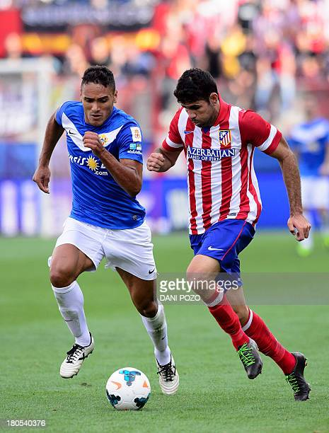 Atletico Madrid's Brazilian forward Diego da Silva Costa vies with Almeria's Uruguayan defender Marcelo Andres Silva Fernandez during the Spanish...