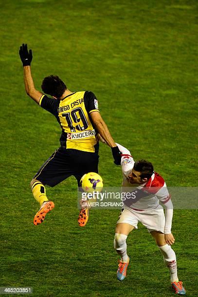 Atletico Madrid's Brazilian forward Diego da Silva Costa vies with Rayo Vallecano's defender Tito during the Spanish league football match Rayo...