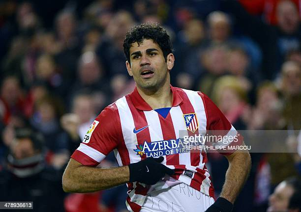 Atletico Madrid's Brazilianborn forward Diego da Silva Costa celebrates after scoring during the Spanish league football match Club Atletico de...