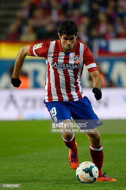 Atletico Madrid's Brazilianborn forward Diego da Silva Costa controls the ball during the Spanish league football match Club Atletico de Madrid vs...