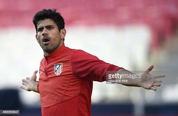 Atletico Madrid's Brazilianborn forward Diego da Silva Costa gestures during a training session of Atletico Madrid on the eve of the UEFA Champions...