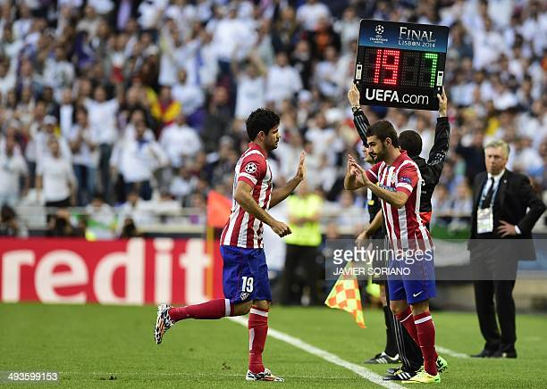 Atletico Madrid's Brazilianborn forward Diego da Silva Costa is substitutes by Atletico Madrid's forward Adrian Lopez during the UEFA Champions...