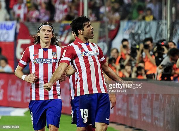 Atletico Madrid's Brazilianborn forward Diego da Silva Costa celebrates past Atletico Madrid's Brazilian defender Filipe Luis after scoring during...