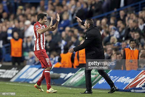 Atletico Madrid's Brazilianborn forward Diego da Silva Costa celebrates scoring his team's second goal with Atletico Madrid's Argentinian coach Diego...