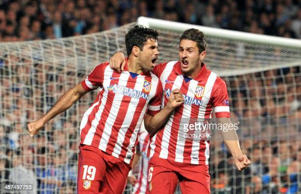 Atletico Madrid's Brazilianborn forward Diego da Silva Costa celebrates scoring his team's second goal with Atletico Madrid's Spanish midfielder Koke...
